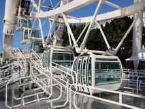 White Solid Ferris Wheel Cabins Closeup Perspective. Closeup Perspective on White Solid Ferris Wheel Cabins Stock Photos