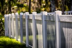 White Solid Privacy Vinyl Fence. 4 feet  White Solid Privacy Vinyl Fence  around your house Royalty Free Stock Image