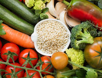 White sorghum grain in a bowl with vegetables. Top view Royalty Free Stock Image