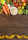 White sorghum grain with vegetables and measuring type. On wood Stock Image