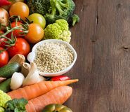 White sorghum grain with vegetables. On wood Royalty Free Stock Photo