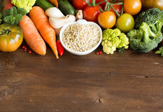 White sorghum grain with vegetables. On a wooden table Stock Photo