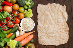 White sorghum grainl with vegetables and craft paper on wood. White sorghum grain in a bowl with vegetables and craft paper on wood Stock Photography