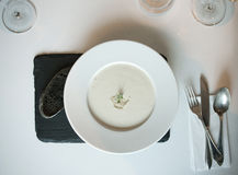 White soup with black bread Royalty Free Stock Photos