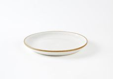 White soup plate with brown rim Royalty Free Stock Image