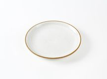 White soup plate with brown rim Royalty Free Stock Photography