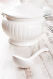 White soup tureen and ladle Stock Photo