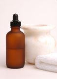White Spa. Amber bottle, marble vase and a towel on white Royalty Free Stock Photography