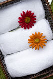 White spa bathroom towels. White cotton spa bathroom towels in a woven basket royalty free stock image