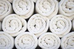 White spa towels. Rolled up white spa towels stock photos