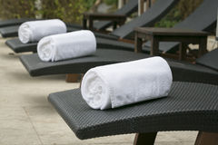 White spa towels. Rolled up white spa towels royalty free stock images