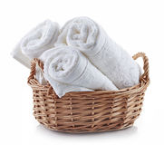 White spa towels in a basket Stock Images