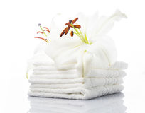 White spa towels. With lily on white royalty free stock photos
