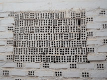 White Spanish Brick Wall. White Spanish Bricks placed end ways in part of wall in Lanjarón, Spain Royalty Free Stock Photo