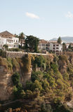 White spanish buildings built on the cliffs edge at Ronda Royalty Free Stock Photos