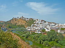 White Spanish village on a hill in sunlight Royalty Free Stock Image