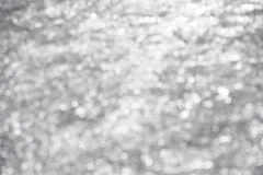 White Sparkles on Gray Background Royalty Free Stock Images