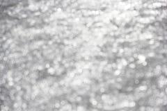 White Sparkles on Gray Background. White Blurred Sparkles on soft grey background that can be used for holidays, awards, celebrations Royalty Free Stock Images