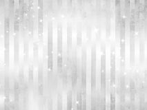 White sparkles - silver background Royalty Free Stock Images
