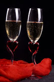 White sparkling wine for two. Two romantic wineglasses with white sparkling wine Royalty Free Stock Photos