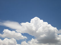White sparse clouds over blue sky Stock Photo