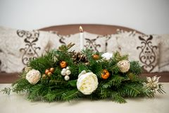 White Special ornaments for Christmas days. Special ornaments for Christmas days on a table with a candle Royalty Free Stock Image