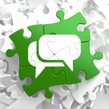 White Speech Bubble Icon on Green Puzzle. Stock Image