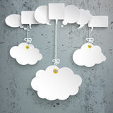 White Speech Bubbles 3 Hanging Clouds Concrete. White speech bubbles with 3 clouds on the concrete background Royalty Free Stock Photo