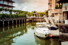 White speed boat in the canal Stock Image