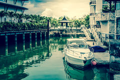 White speed boat at the pier, Vintage style photograph Royalty Free Stock Photos