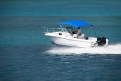 White Speedboat. A white speedboat in the Caribbean stock photos