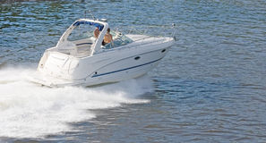 White speedboat at height of summer Stock Photography