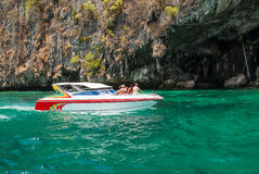 White speedboat with tourists at the cave Royalty Free Stock Photos