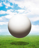 White Sphere Over Grass Stock Photo