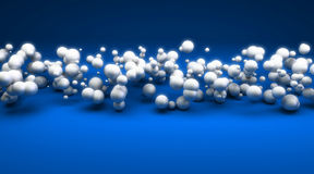 White spheres against blue background. 3D rendering of white spheres floating on a blue background Stock Photography