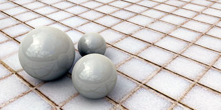 White spheres on tiled floor Royalty Free Stock Photo