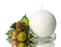 White spherical candle with christmas decoration Royalty Free Stock Photo