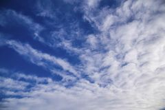White spindrift clouds Stock Image