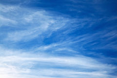 White spindrift clouds on blue sky Stock Images