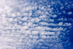 White spindrift clouds on blue sky, background stock photo