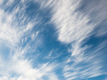 White spindrift clouds in the sky Stock Photo