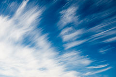 White spindrift clouds in the sky Stock Photos