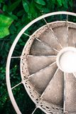White spiral staircase and plants stock photography