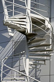 White spiral stairs. Metal white spiral stairs on the outside of a factory Stock Image