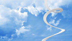 White spiral stairs goes in blue cloudy sky. White spiral stairs goes up in blue cloudy sky Royalty Free Stock Photography