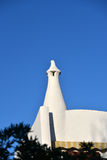 White spire of the building under a blue sky. White spire of the building Royalty Free Stock Photos