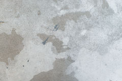 White splash on gray background concrete wall, messy, splotchy, surface. Decorative wet paint drops, abstract art. Stock Photos