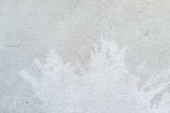 White splash on gray background concrete wall, messy, splotchy, surface. Decorative wet paint drops, abstract art. White splash on gray background concrete wall Royalty Free Stock Image