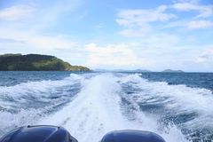 White splash wave water surface behind fast motor speed boat Stock Images