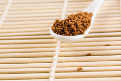 White spoon with coffee granules Stock Photos